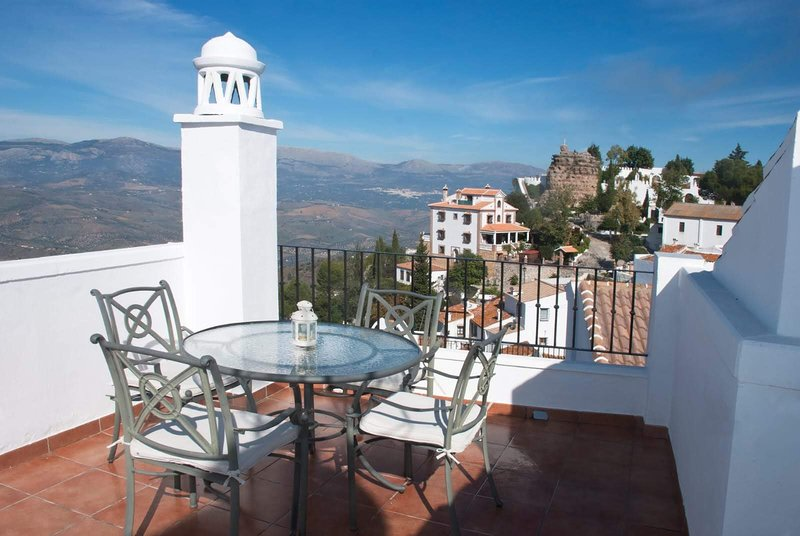 Our roof terrace with a breathtaking view at the Sierra Tejeda.