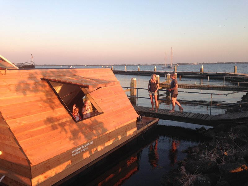 A wonderful moment on your own terrace with the view over the IJmeer towards Muiden and Amsterdam