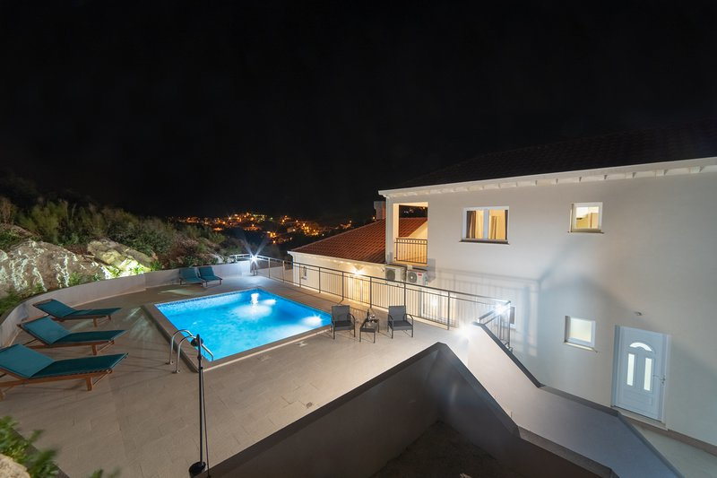 House and pool by night