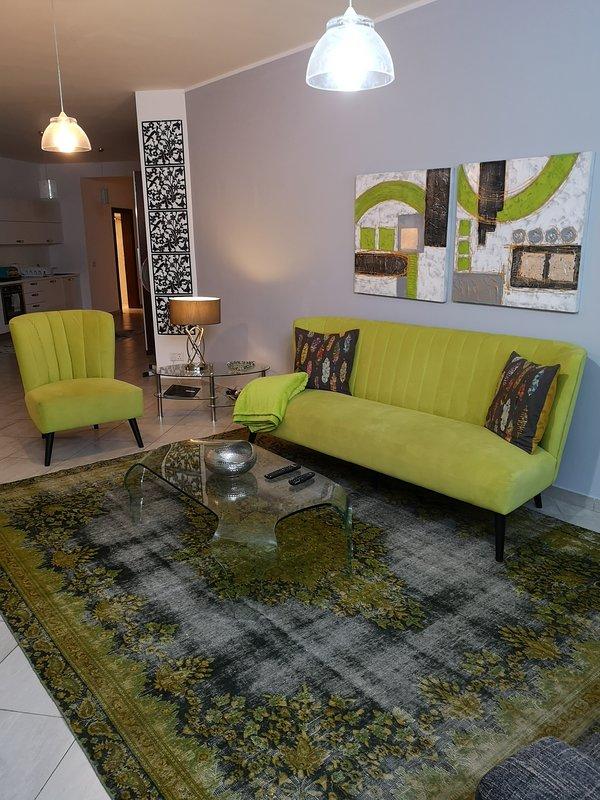 Stylish lounge interleading to the modern kitchen
