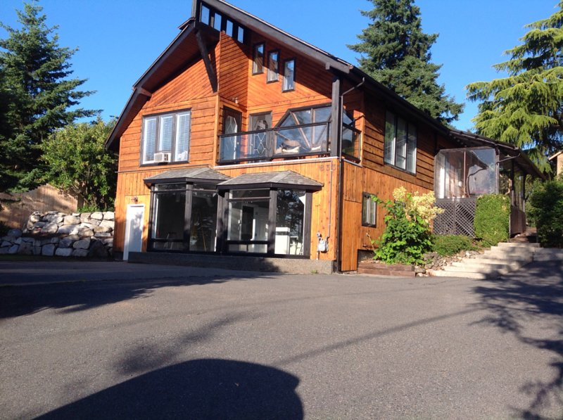 Upper apartment, in this chalet home, located on a secluded half acre, a 30 minute walk to downtown