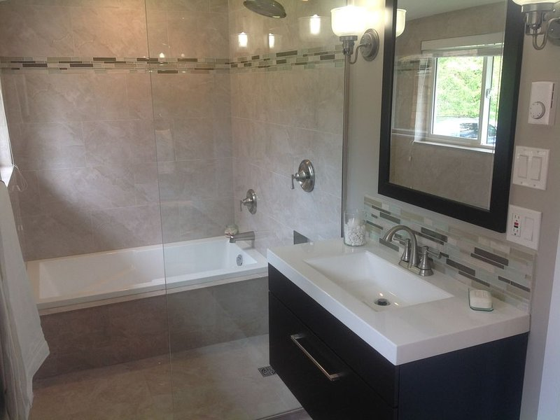 Beautifully renovated main bathroom, with soaker tub and shower