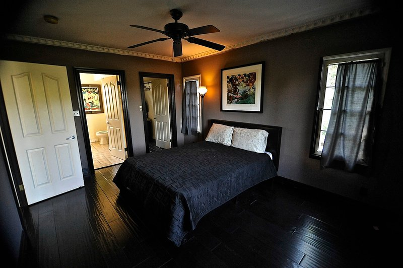 Reverse view of bedroom, complete with fridge, ceiling fan, HD TV, and locking door