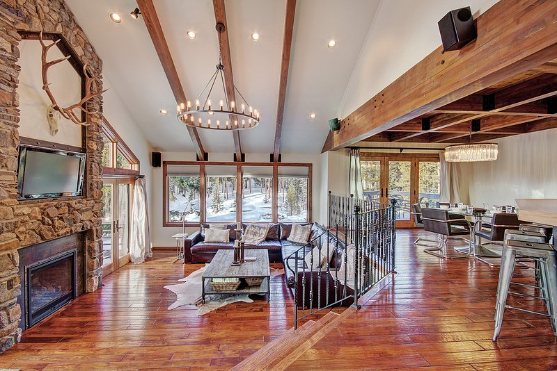 Large open floor plan living area with lofted ceilings