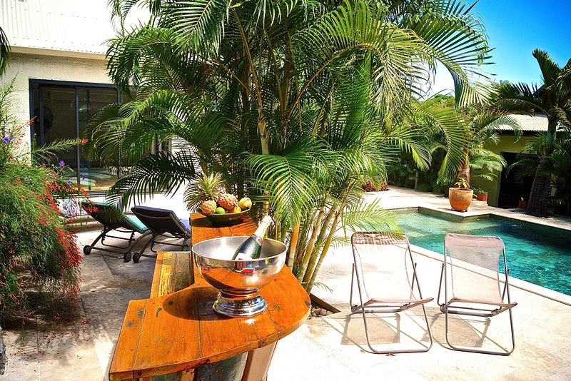Superb terrace around the pool with an Indonesian bar