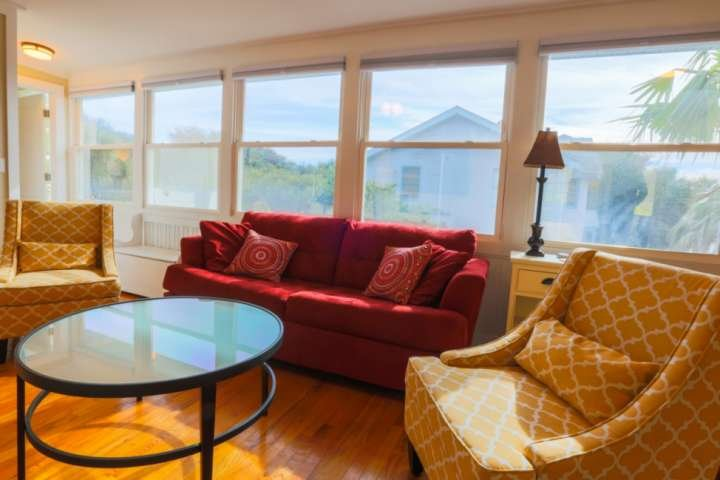 Once you enter the front door, you will find our sun room with an overstuffed sofa, arm chairs and a smart TV.