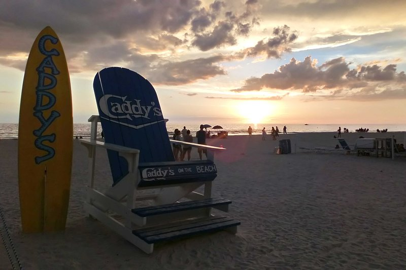 Walk over to Caddys on the Beach for some delicious local cuisine!