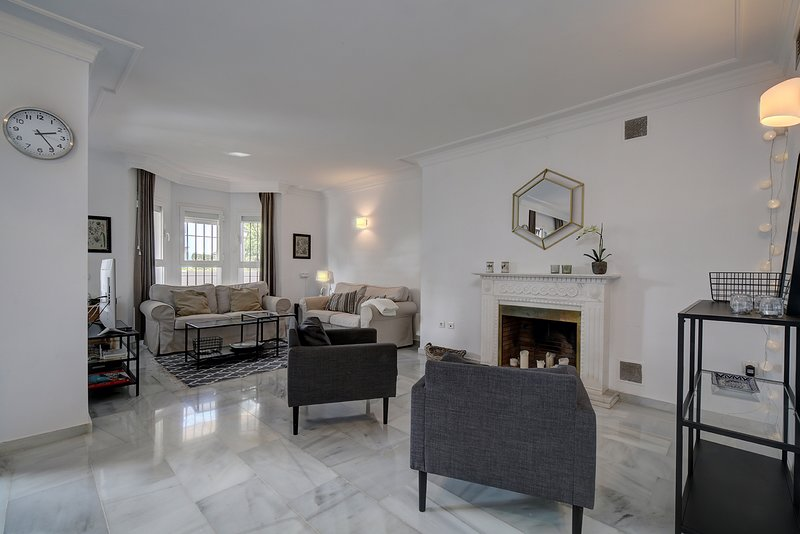 The living room, with a fireplace, where your family can sit and relax.
