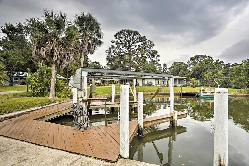 This canalfront Englewood home features a private, on-site boat dock.