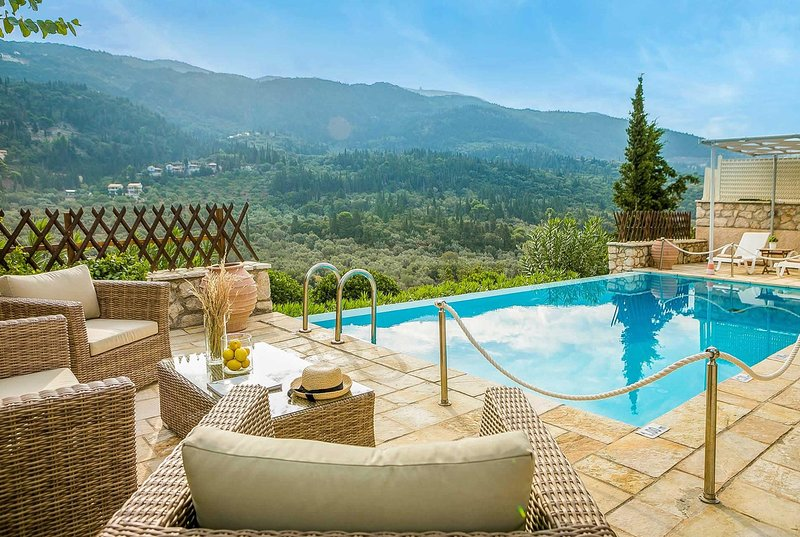 Hillside location w/ amazing views, WIFI and pool, holiday rental in Exanthia
