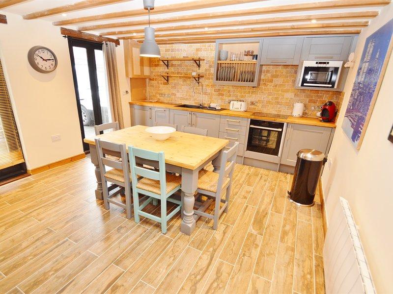 Cucina e sala da pranzo piena di fascino e carattere