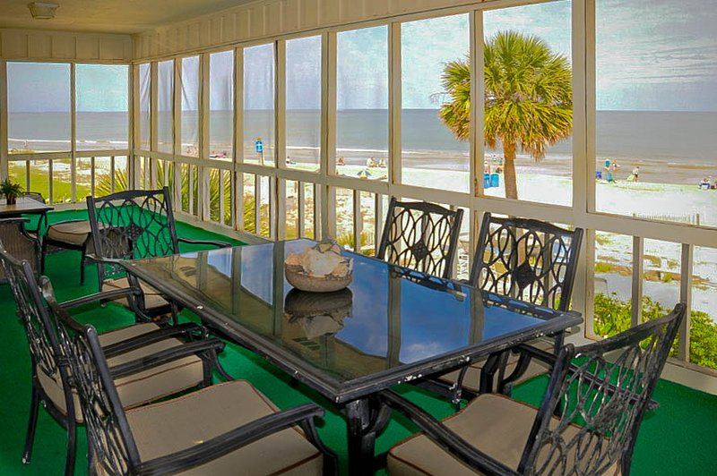 Panoramic view from huge private screened porch with dining and seating areas