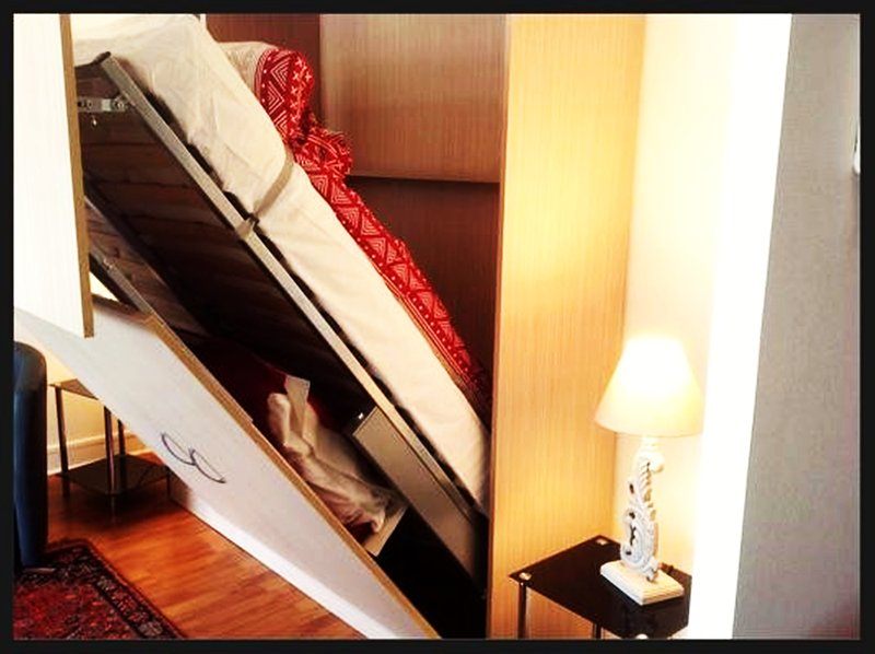 Bed lodged in the wardrobe.