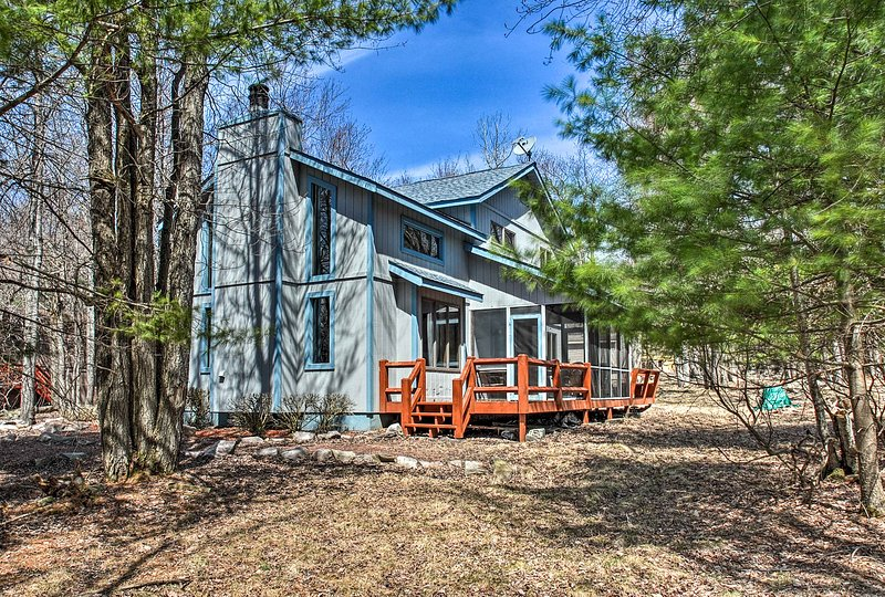 Surrounded by towering pines, this property offers a secluded getaway.