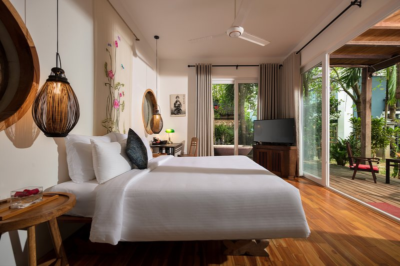 3 ensuite bedroom villa with terrace & tropical garden looking to the swimming pool.