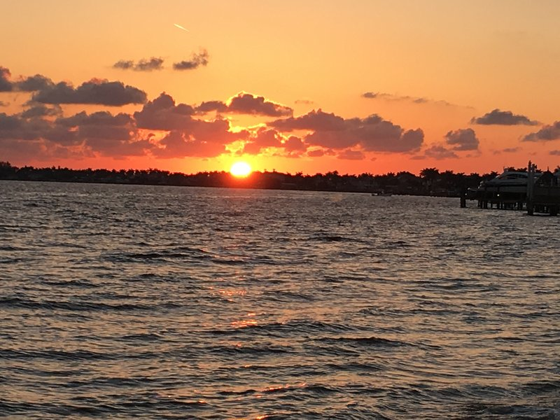 Dine at the Boat House Bar & Grill while watching these dramatic sunsets!!