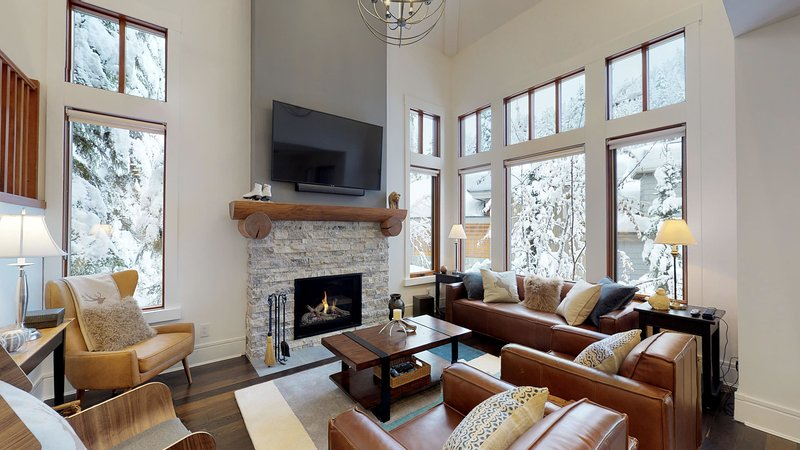 Living area featuring a flat screen TV, stereo and a cozy gas fireplace