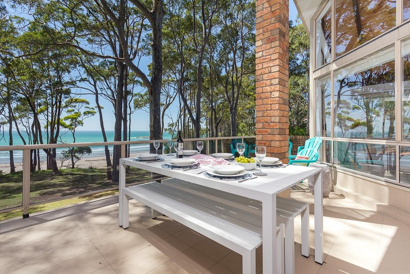 Alfresco dining on the balcony, as you overlook Denhams Beach