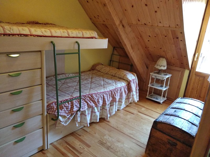 Room with balcony, two comfortable bunk beds with wardrobe.