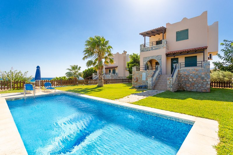 Beautiful villa with private pool, lawn, and terrace with sea views