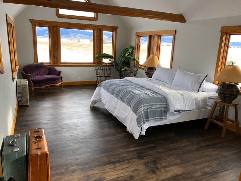 Enjoy breathtaking scenery and plenty of space to relax in the inviting master bedroom.