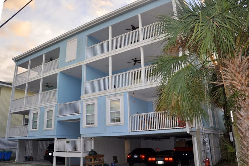Exterior of Tybee Retreat with 3 large covered balconies