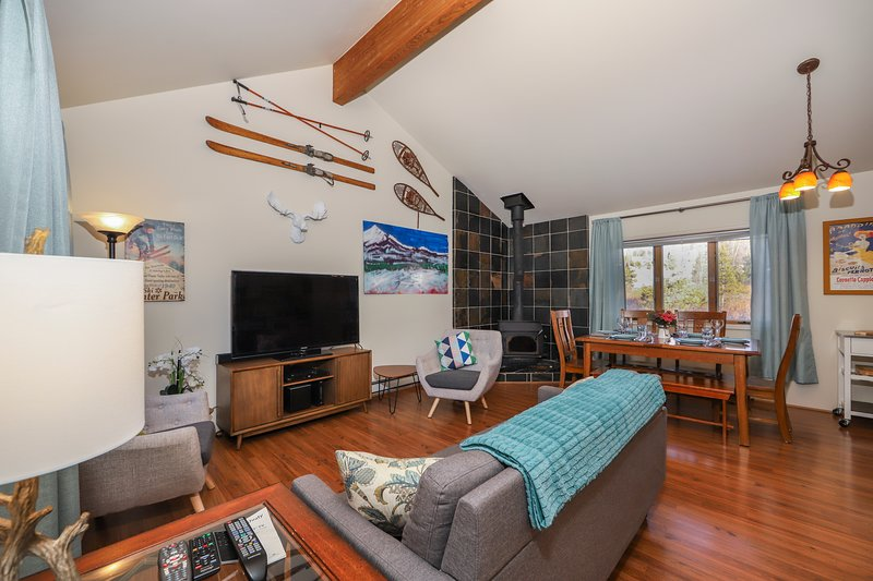 This Winter Park Resort area ski condo's Upper-level living area has a vaulted ceiling and mid-century modern furniture.