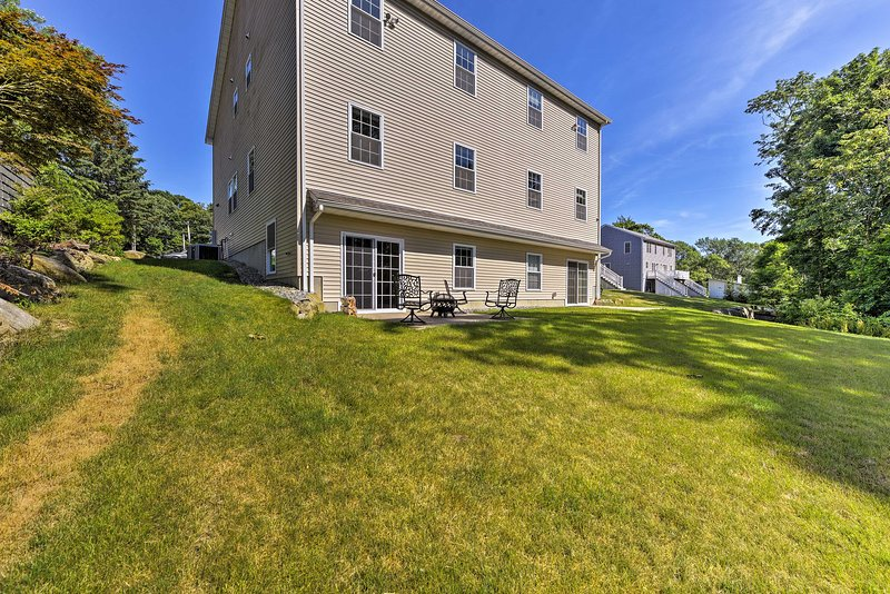 The spacious lawn is perfect for gathering with family or friends.