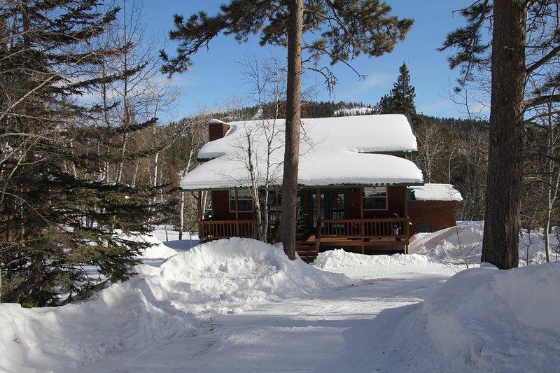 Temporada de esquí - Terry Peak Ski Area en el fondo