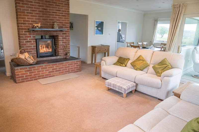 Enjoy our cosy living room with a modern wood-burning stove and plenty of comfortable seating
