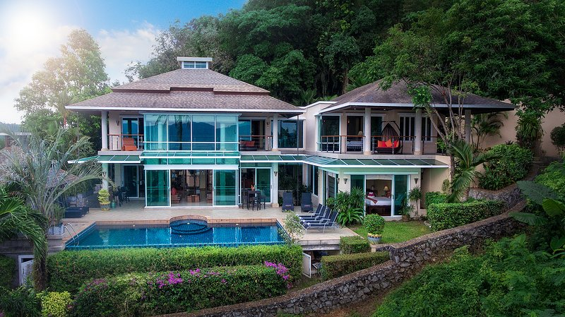 Unique architect designed villa is surrounded by landscaped tropical gardens.