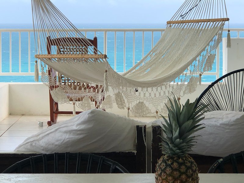 Hammock or rocking chair? Rest, relax, nap on the open balcony w soaring views of the Atlantic Ocean