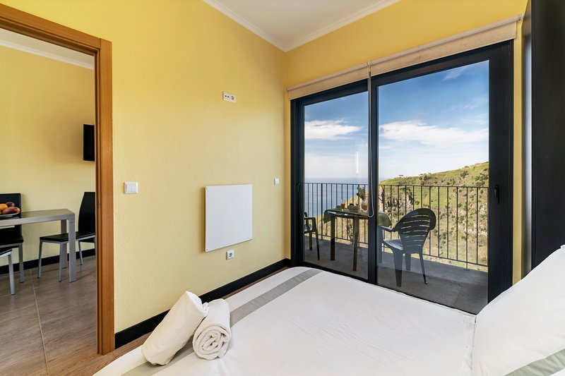 On the cliffs with ocean view, perfect for walking – Top of the Cliff Apartment, vacation rental in Faja da Ovelha