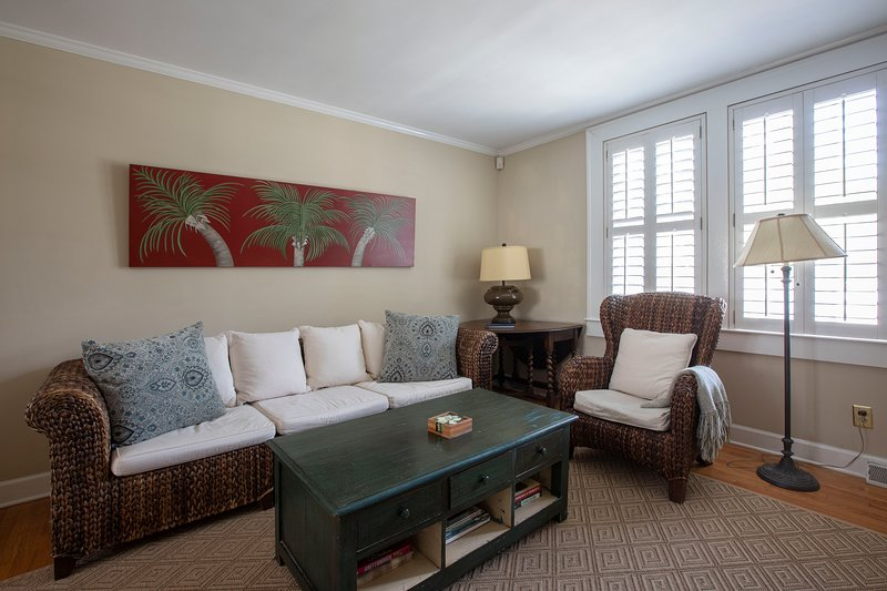 Living room with plantation shutters and  plenty of seating.