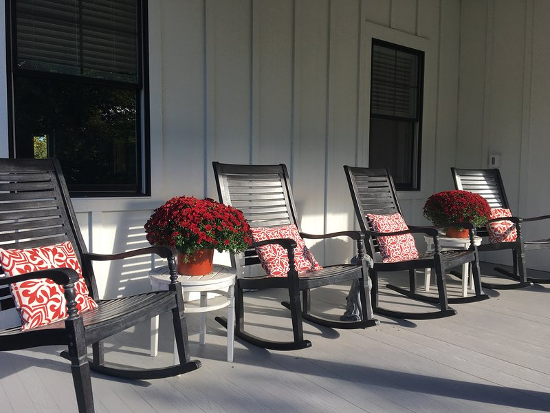 Enjoy a glass of wine or iced tea on the beautifully appointed front porch.