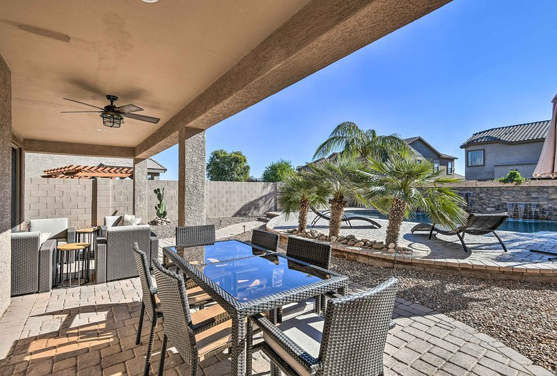 Stunning palm trees, a private pool, and patio area highlight this lovely home.