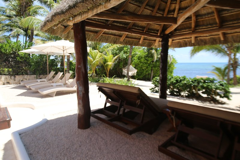 Under the palapa relaxing on the sun beds overlooking the sea!
