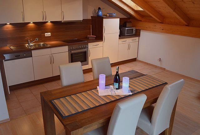 spacious kitchen with dish washer, oven, micro wave, coffee machine, toaster etc