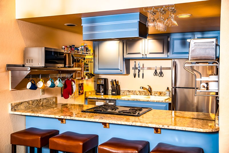 Granite countertop, stainless steel, chef's kitchen, espresso bar, fully stocked.  4 bar stools.