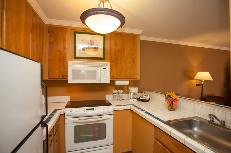 The fully-equipped kitchen features all the amenities you'd need to make a delicious meal.