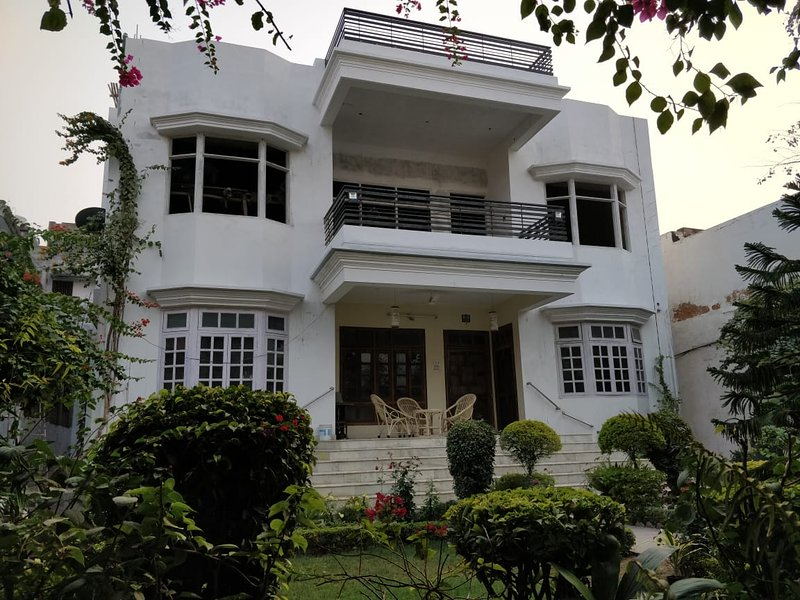 Front portion of the house with a veranda and a garden to sit and relax.