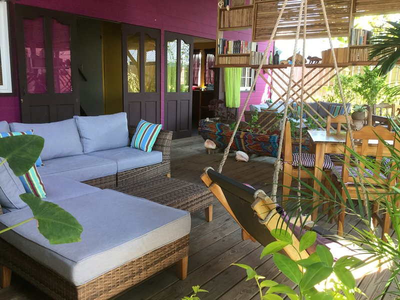 Your Purple House 1 personal deck space with lounge, dining area, hammock chair and hammock