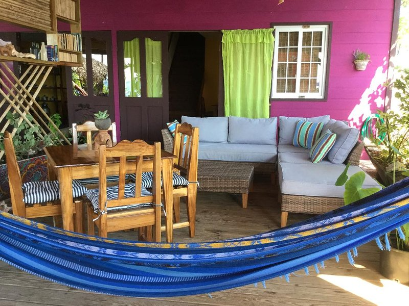Your personal front deck with lounge dining table, hammock chair and hammock