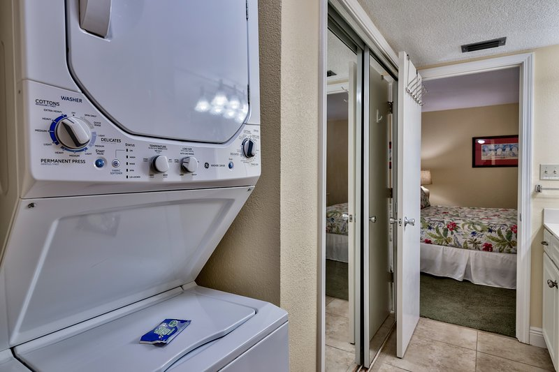 Unit features stacked washer and dryer