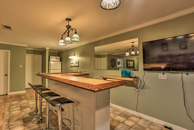 The 3-bedroom, 3-bath apartment features a bar area and 3 flat-screen Smart TVs.