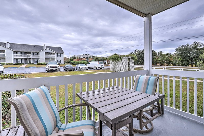 The ground-floor vacation rental condo offers a furnished balcony & pool access!