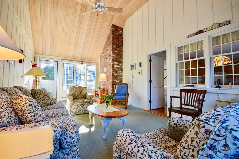 Sunny breezeway with comfortable seating