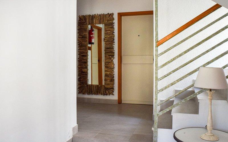 Escalier menant aux appartements des premier et deuxième étages