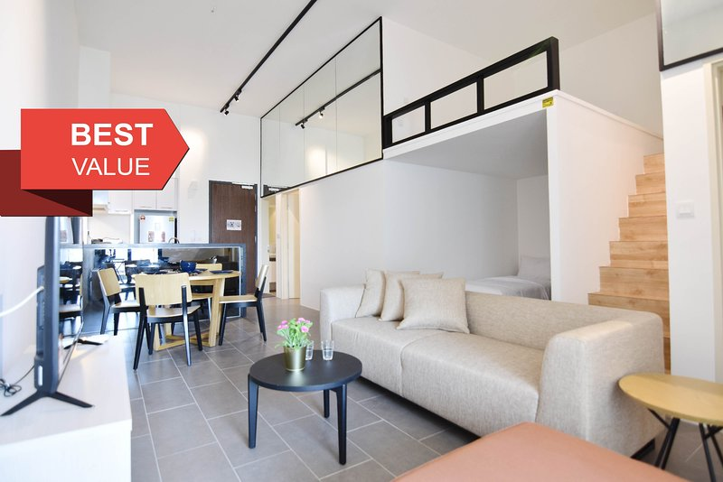A spacious & well furnished 3-bedroom loft unit.
