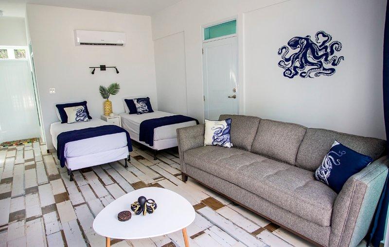 ★ Pulpo Loco Loft | Stylish, Sparkling Clean Loft | Walk to Sandy Beach ★, vacation rental in Puerto Rico
